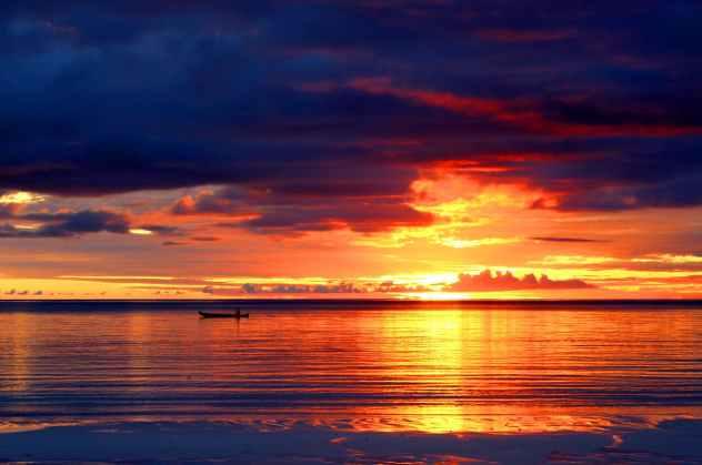 backlit beach dark clouds dawn